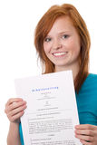 My first employment. Red-haired girl with contract Royalty Free Stock Image