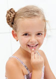 My first encounter with the tooth fairy. Young girl showing missing teeth Stock Photo