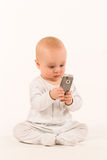 My first phone. Isolated baby with mobile phone Stock Photo