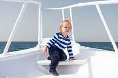 My first travel. Baby boy enjoy vacation on cruise ship. Child cute sailor yacht sunny day. Adventure of boy sailor. Travelling sea. Boy adorable sailor striped royalty free stock images
