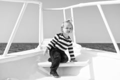 My first travel. Baby boy enjoy vacation on cruise ship. Child cute sailor yacht sunny day. Adventure of boy sailor. Travelling sea. Boy adorable sailor striped royalty free stock photo