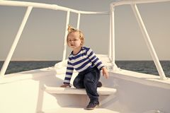 My first travel. Baby boy enjoy vacation on cruise ship. Child cute sailor yacht sunny day. Adventure of boy sailor. Travelling sea. Boy adorable sailor striped stock images