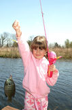 My fish. A young girl holding the fish she caught stock photo