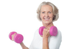 My fitness secret. Fitness woman working out with dumbbells Royalty Free Stock Photography