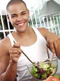 My fresh salad. Young afro american preparing fresh salad Royalty Free Stock Photo