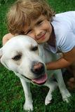 My friend. Four year old girl with labrador retriever stock photos