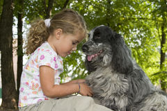 My friend and I. Little girl talking to her dog Stock Image