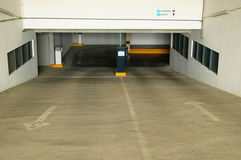 My garage. Public garage entrance framed by white walls with windows Stock Images