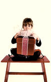 My gift. A little girl sits on a bench with her christmas gift stock photo