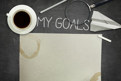 My goals concept on black blackboard with coffee Stock Image