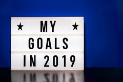 My goals 2019 sign - cinema style lettering on light box. & blue background royalty free stock photo