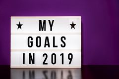 My goals 2019 sign - cinema style lettering on light box. My goals 2019 sign - success - cinema style lettering on light box with purple background stock images