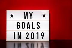 My goals 2019 sign - cinema style lettering on light box & warm red background. Block colour royalty free stock photos