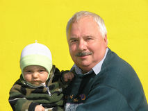My grandfather. Grandfather and grandson on yellow background Stock Photos