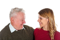 My grandpa needs some diet. Picture of a beautiful young women posing with her grandfather - isolated background Royalty Free Stock Photography