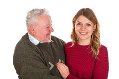 My grandpa needs some diet. Picture of a beautiful young women posing with her grandfather - isolated background Stock Photos