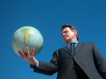 In My Hand. Man holding globe with one hand royalty free stock photos