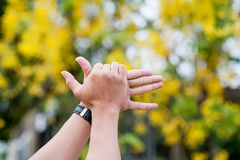 My hand and my black watch royalty free stock images