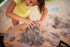 My hands are creating something new. Children`s hands are playing in the sand. Close up. Space for copy royalty free stock photography