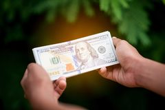 How to Make Money Online And the money to do business. Financial stock photography
