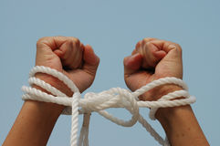 My hands are tied. Pair of hands bound with rope � metaphor for �my hands are tied stock images