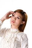 My head hurts. Young adult woman with a headeach waering a white blouse and white background Stock Image