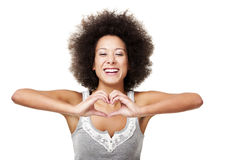 In my heart. Beautiful young woman making a heart with hands, isolated on white Royalty Free Stock Image