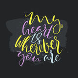 My heart is wherever you are text.Card with calligraphy. Handdrawn romantic lettering quote.Great for posters, mugs, apparel design, print Stock Photo