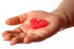 My heart for you. Lighting heart candle on woman's hand Royalty Free Stock Image