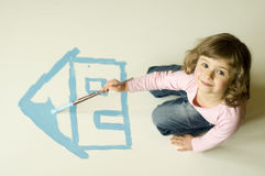 My home. Little girl painting blue house Stock Images