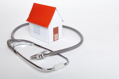 My home health. Requirements of the house. Paper house with stethoscope that indicates the health of the house Stock Photo