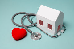 My home health. Requirements of the house. Paper house with stethoscope that indicates the health of the house Stock Image