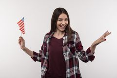 Joyful young woman holding the US symbol. My homeland. Joyful young woman holding the US symbol while thinking about her country Stock Images