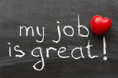 My job is great. Positive concept phrase handwritten on black chalkboard with volume red heart symbol Stock Photos