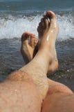 My legs in blue sea Stock Photo