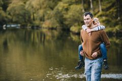 My Legs are Tired!. Little boy is receiving a piggyback from his father while they are hiking through the Lake District Royalty Free Stock Images