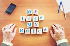 My life My rules. Businessman made text from wooden cubes stock image