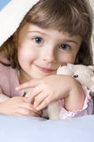 My little bear. Little girl under blanket with teddy bear Royalty Free Stock Photo