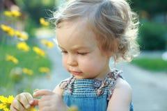 My little garden. Cute child explorer flowers in garden stock images