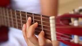 My little girl playing guitar stock photography