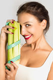 My little secret slenderness ... Portrait of a beautiful slim girl with celery Royalty Free Stock Image