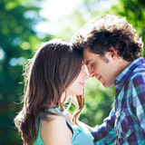My Only Love. Close-up of happy men embracing his girlfriend outdoors with eyes closed Stock Photo