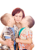 My love in a kiss, mother!. Little boy giving a kiss to her mother isolated Royalty Free Stock Images