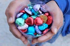 Love heart chocolate hand give Stock Photo