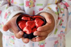 Love chocolate child valentine heart Stock Images