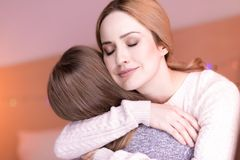Devoted mum hugging her daughter Royalty Free Stock Photo