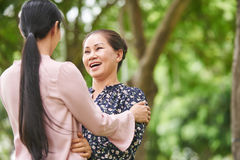 My lovely daughter. Senior Vietnamese women is happy to see her daughter Royalty Free Stock Images