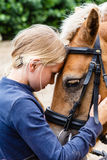 My lovely horse. Young girl loves her horse Royalty Free Stock Images