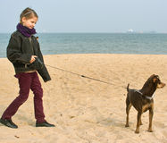 My lovely pet. Girl and her dog on the beach Royalty Free Stock Images