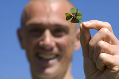 My Lucky Day. This man found a four leaf clover, it's his lucky day royalty free stock image
